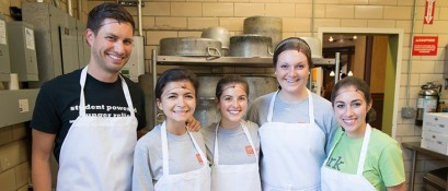 Merrimack College students pose at their Campus Kitchen.