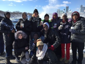 Niagara University's Deborah Curtis poses with a cohort of refugee students at Niagara Falls. Photo courtesy of Niagara University.